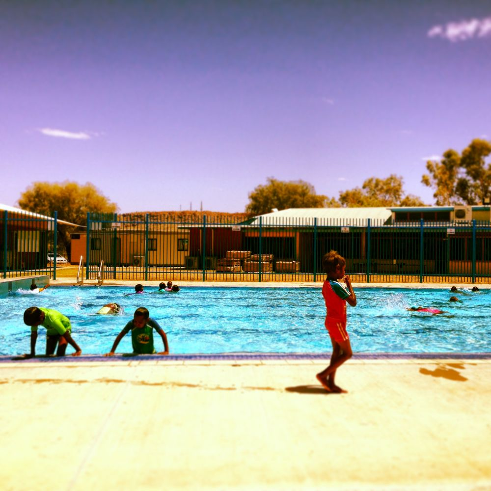 Students play in the pool at lunch