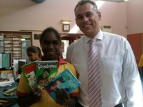 Adam Giles MLA (Member for Braitling) presents books to students